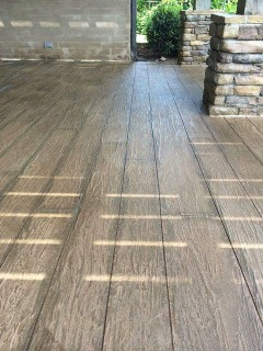 Wood decks need to much maintenance, sand/stain/seal every year...not concrete. Looks like wood, but beats wood in every way!