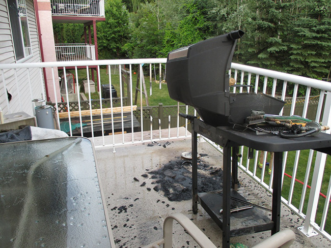 A gas grill flared up and ignited the deck. Always clean your grills gas venturi tubing. Siders etc can block the flow causing an explosion.